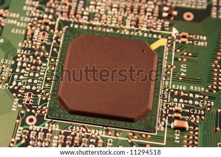 A close up of a computer motherboard chip. - stock photo