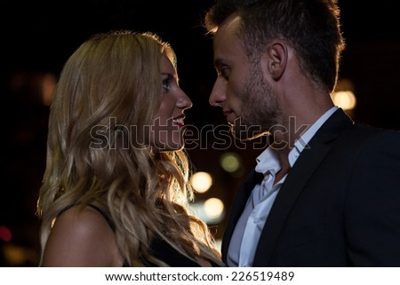 A close up of a couple in love looking into each other's eyes - stock photo
