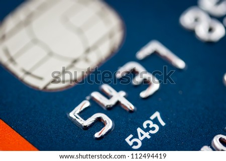 A close up of a credit card number and chip - stock photo