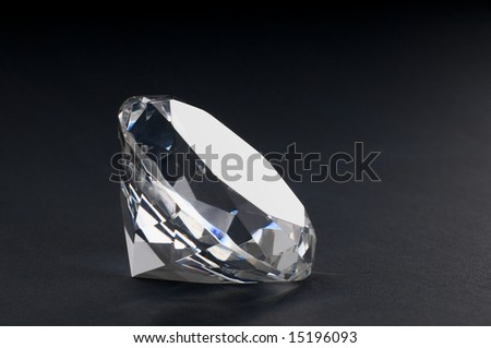 A close up of a diamond on black  background - stock photo