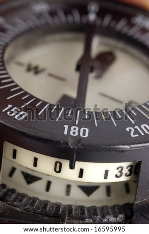 A close up of a diving compass with selective focus