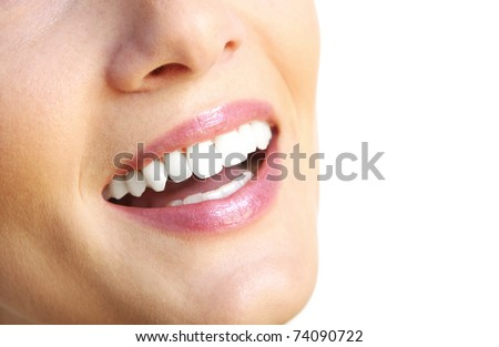 A close up of a female beautiful smile over white background