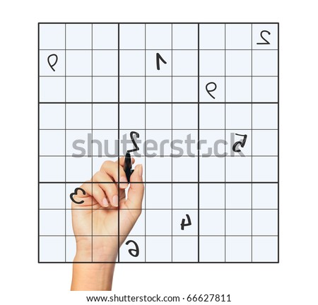 A close up of a female hand solving sudoku over white background - stock photo