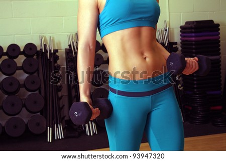 A close-up of a female torso with exceptional abdominal muscle tone. - stock photo