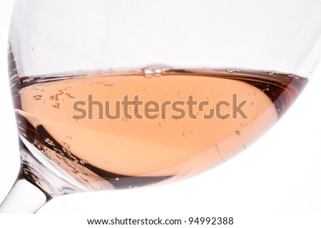 A close-up of a glass rose wine with carbonic acid - stock photo