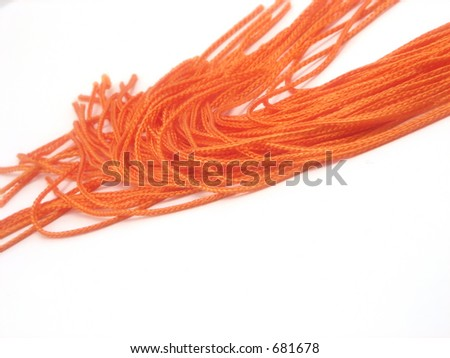A close-up of a graduation tassel with a shallow depth of field - stock photo