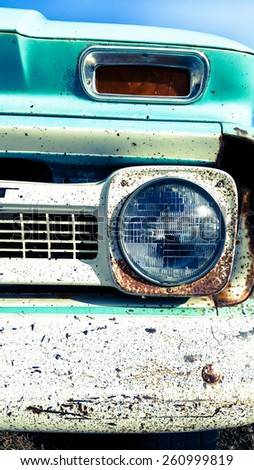 stock-photo-a-close-up-of-a-headlight-and-the-corner-of-the-bumper-on-an-old-abandoned-truck-260999819.jpg