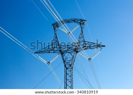 A close up of a high voltage electric pylon and tower. - stock photo