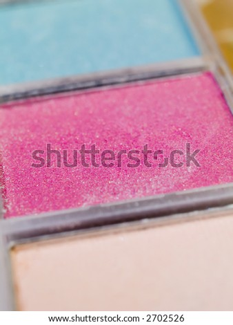 A close-up of a kit of eye shadow. Shallow DOF. - stock photo