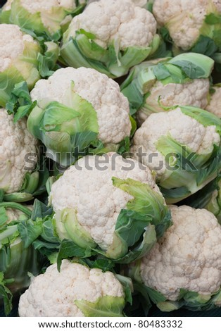 A close up of a large stack of Cauliflower. - stock photo