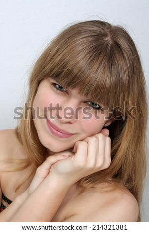 A close-up of a lovely teenage girl with a with a warm smile.  - stock photo