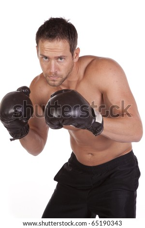 A close up of a man in boxing gloves with a serious expression on his face. - stock photo