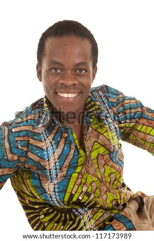 A close up of a man in his colorful shirt with a smile on his face. - stock photo