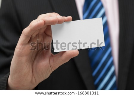 A close up of a man with a business card