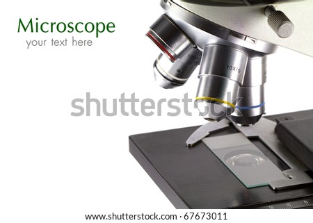 A close-up of a microscope on white background with copy space. - stock photo