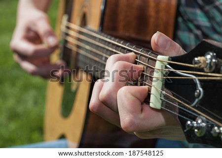 A close up of a musician's hand - stock photo
