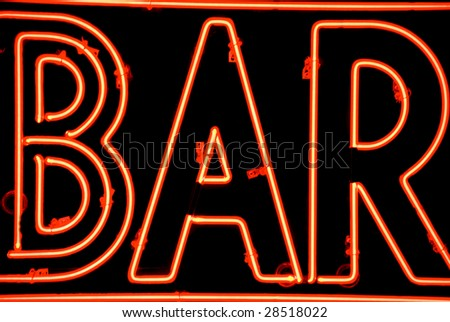 A close-up of a neon red bar sign - stock photo