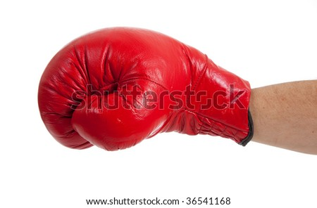 A close-up of a persons arm throwing a punch with a red boxing glove on a white background - stock photo