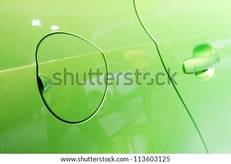 A close up of a petrol cap cover on a modern car - stock photo