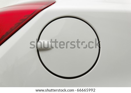 A close up of a petrol cap cover on a modern white car - stock photo