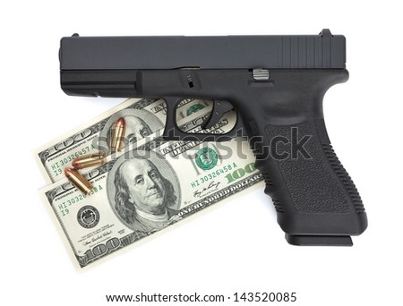 A close-up of a pistol, ammo and money isolated on a white background - stock photo