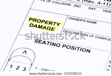 A close up of a police report listing property damage - stock photo