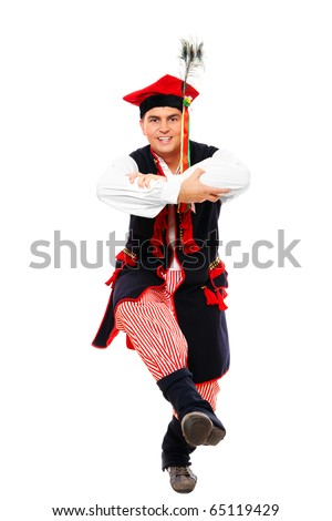 A close-up of a Polish traditional dancer dancing over white background
