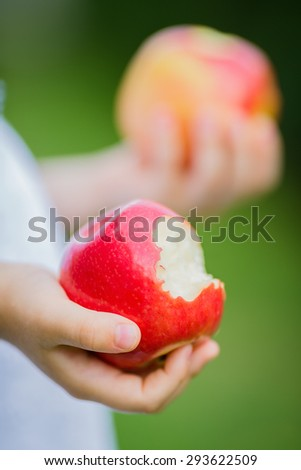 A close-up of a ripe and bitten apples - stock photo