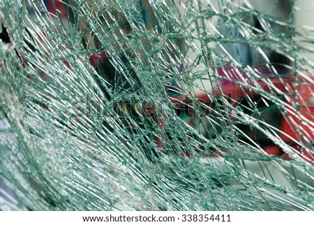 A close up of a shattered car windscreen - stock photo