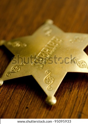 a close up of a Sheriff's badge. - stock photo