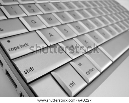 A close-up of a Shift key with the other keys out of focus - stock photo
