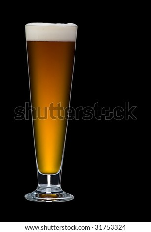 A close up of a single glass of beer on a black background. Beer is a lovely golden colour with white frothy bubbles on top.