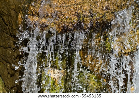 A close up of a small waterfall - stock photo