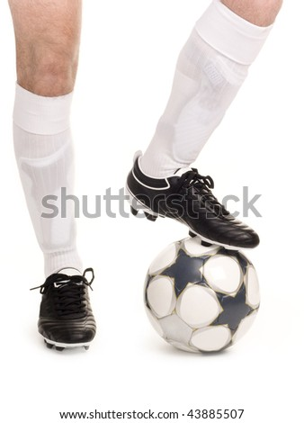 A close up of a soccer ball and shoes - stock photo