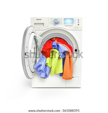 A close up of a washing machine loaded with clothes isolated on white background - stock photo