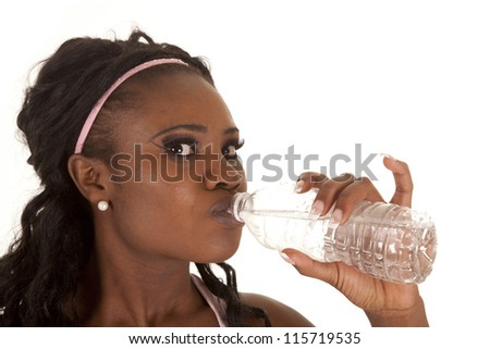 A close up of a woman drinking from a bottle of water. - stock photo