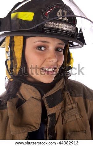 A close up of a woman firefighter with a smile on her face. - stock photo