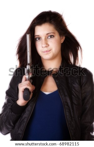 A close up of a woman holding a handgun with a serious expression on her face. - stock photo