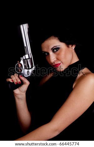 A close up of a woman holding her pistol up in the air. - stock photo