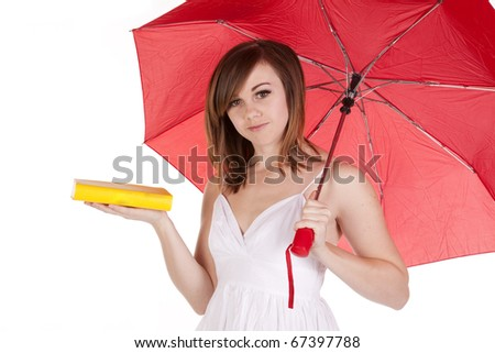 A close up of a woman holding her red umbrella  and her yellow book.