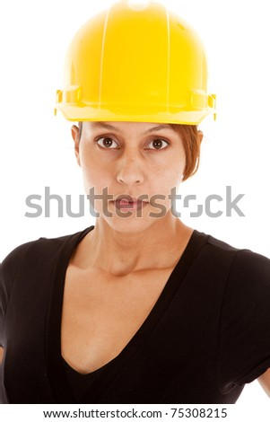 A close up of a woman in a yellow hard hat.