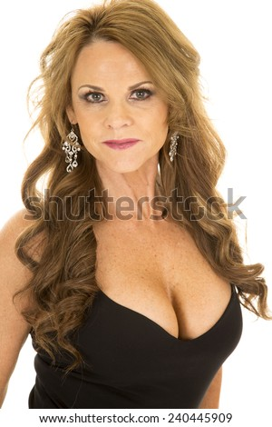 A close up of a woman in her black dress with a serious expression on her face. - stock photo