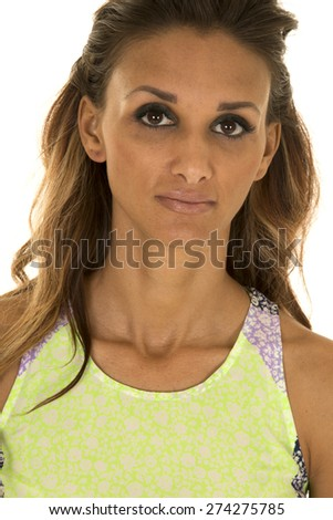 A close up of a woman in her stylish tank with a serious expression. - stock photo