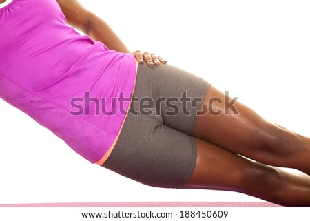 A close up of a woman's body working out and lifting her body off of the ground, - stock photo