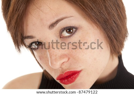A close up of a woman's face looking into the camera with a sexy expression on her face.