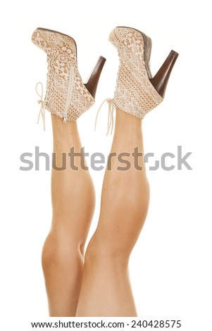 a close up of a woman's legs with her lace heels on her feet. - stock photo
