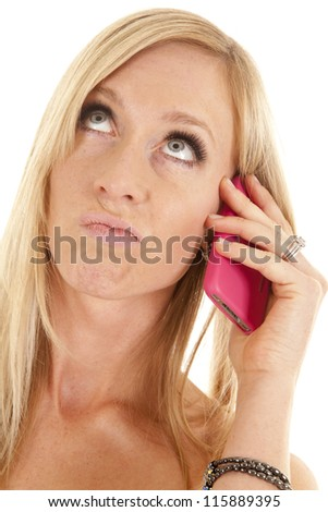 a close up of a woman talking on the phone with  a confused expression on her face. - stock photo