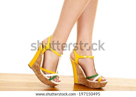 A close up of a woman walking in her shoes. - stock photo