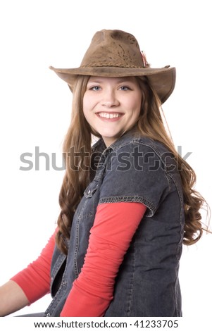 A close up of a woman with a hat on with a big smile on her face. - stock photo