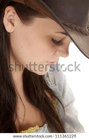 A close up of a woman with her hat on and her eyes closed. - stock photo